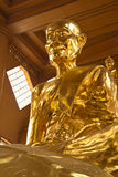 Buddha statue. Golden Buddha statue in a Buddhist temple Stock Photography