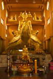 Buddha statue. Golden Buddha statue in a Buddhist temple Stock Images