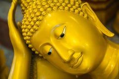 Buddha statue. Golden buddha statue sleep in temple Stock Photos