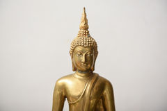 Buddha statue. The golden Buddha statue on white background Royalty Free Stock Photography