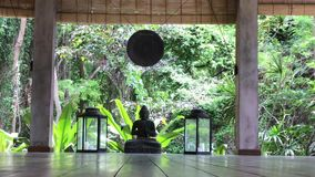 Buddha statue and a gong at an area for yoga classes stock video