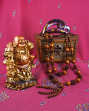 Buddha statue, hairpin, beads made of wood, jewelry box Stock Photo