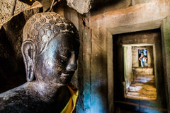 Buddha statue in a hallway Stock Image
