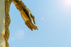 Buddha statue hand gold of Sky and sunshine royalty free stock photography