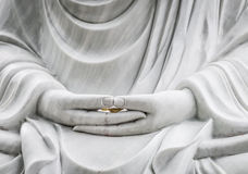 Buddha statue with hands as main subject. Royalty Free Stock Photo