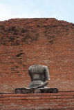 Buddha statue headless with the old red wall background Stock Photography