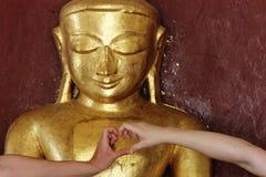Buddha statue and heart Stock Photos
