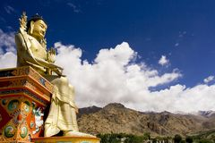 Buddha statue and Himalayas Stock Photo