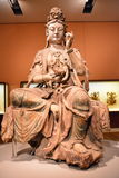 Buddha statue. His is a wooden statue of the Buddha, in 1000 years of the Song Dynasty Chinese, fine carving, the statue`s facial expression is mild, height is 1 Stock Photos