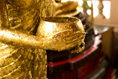 Buddha statue holding bowl Royalty Free Stock Photography