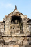 Buddha statue inside of Borobudur temple wall Stock Images