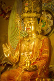 Buddha statue inside the Buddha Tooth Relic Temple and Museum royalty free stock photos