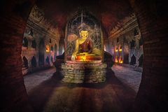 Buddha statue inside old pagoda at Bagan, Myanmar.  stock photography