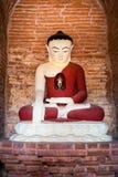 Buddha statue inside Seinnyet Ama Pagoda ruins. Bagan, Myanmar (Burma) Stock Photography