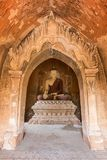 Buddha statue inside a temple in Bagan. Front view of a statue of sitting Buddha inside an untitled simple temple in Bagan, Myanmar Burma Stock Image