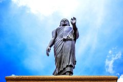 Buddha Statue isolated with blue sky background. royalty free stock photography