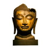 Isolated shot of golden statue of Buddha sitting in lotus pose with eyes shut