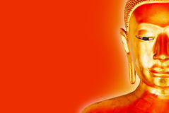 Buddha Statue Isolated with yellow aura on a red Background. Half Face View of a old Buddha Statue Isolated with yellow aura on a red Background stock images