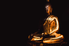 Buddha statue with light dark background . buddha image used as amulets of Buddhism religion Stock Photo