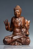 Buddha statue made  polished wood Royalty Free Stock Photo