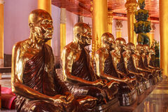 Buddha statue maestro. Lot of golden buddha statue maestro enshrined in Hall Royalty Free Stock Photos