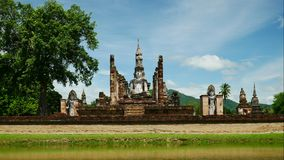 Buddha statue at Mahathat temple in Sukhothai historical park with travelers, famous tourist attraction in   northern Thailand. stock video footage