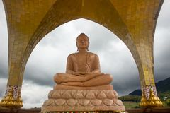 Orange marble buddha statue in meditation pose. Buddha statue in meditation pose Royalty Free Stock Photo