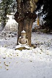 Buddha statue meditation in winter and snow in front of a cherry Stock Photo