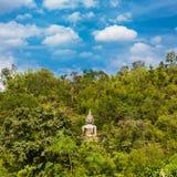 Buddha statue on mountain Stock Photos