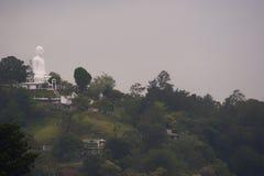 Buddha statue on mountain. White Buddha statue on mountain in Sri Lanka Stock Photos