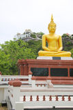 Buddha statue and the moutain background Stock Photo