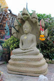 Buddha statue with naga. Stock Image