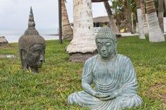 Buddha statue near the shore Stock Photo