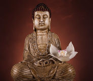 Buddha statue with orchid flower Royalty Free Stock Photo