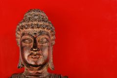 Buddha statue over red Royalty Free Stock Photo
