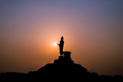 Buddha statue. Over scenic sunset sky background Royalty Free Stock Photo