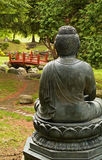 Buddha statue overlooking garden Royalty Free Stock Photos