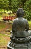 Buddha statue overlooking garden. Buddha statue overloking a japanese garden Royalty Free Stock Photos