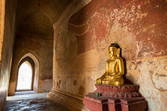 Buddha statue and painting inside a temple in Bagan Royalty Free Stock Photography