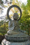 Buddha statue in park with protection gesture Royalty Free Stock Images