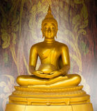 Buddha statue on pattern thai background. Royalty Free Stock Photography