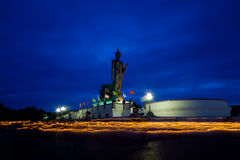 Buddha statue. People walk with lighted candles in hand around a buddha statue @Thailand Visakha Bucha Day Stock Photo