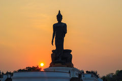 Buddha statue at Phutthamonthon during sunset. Buddhist park in Phutthamonthon district,Nakhon Pathom Province of Thailand).NON-ENGLISH LANGUAGE AT THE BASE IS Royalty Free Stock Photos