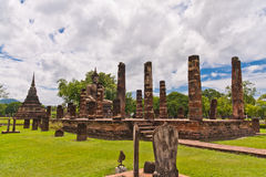 Buddha statue among pillars tilted out. Ruin Buddha statue among ruin pillars in Sukhothai historic park tilted out Stock Photos
