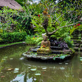 Buddha statue on a pond Stock Image