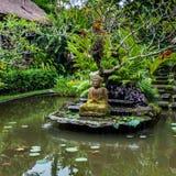 Buddha statue on a pond Stock Image