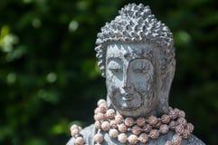 Buddha. Statue portrait in a summer garden Stock Photos