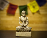 Buddha statue with prayer flag Royalty Free Stock Photography