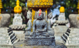 Buddha statue with red color on his forehead  on the square near Swayambhunath stupa Royalty Free Stock Photos