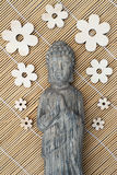 Buddha statue with a reed background Stock Photo